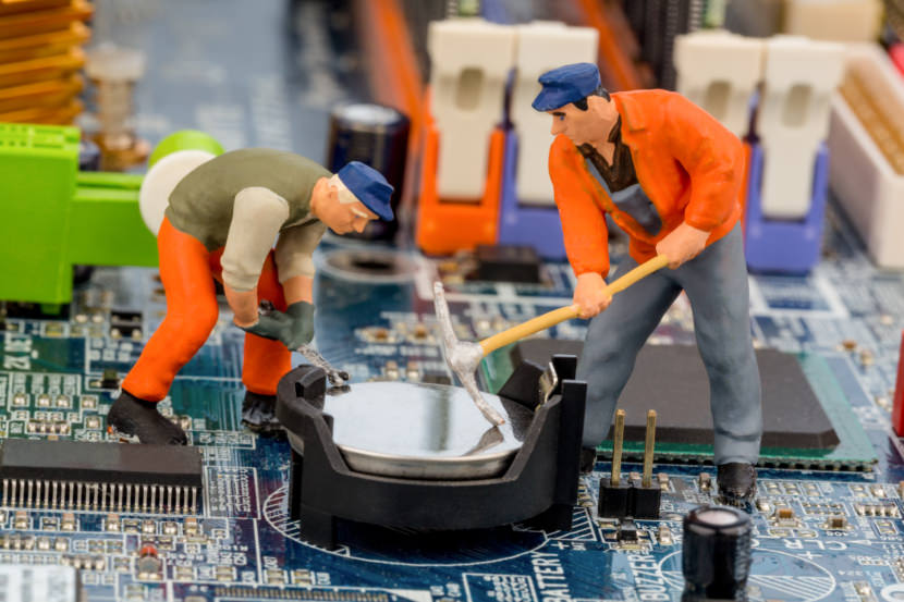 workers fixing PC